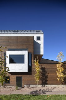 "A Couple's Denver Residence Makes Clever Use of a Narrow Plot - Photo 2 of 8 - Mitchell says that the red cedar ""provided a nice level of contrast from the white siding on top and helps to establish those two spaces as distinctly separate."" The siding is from James Hardie."