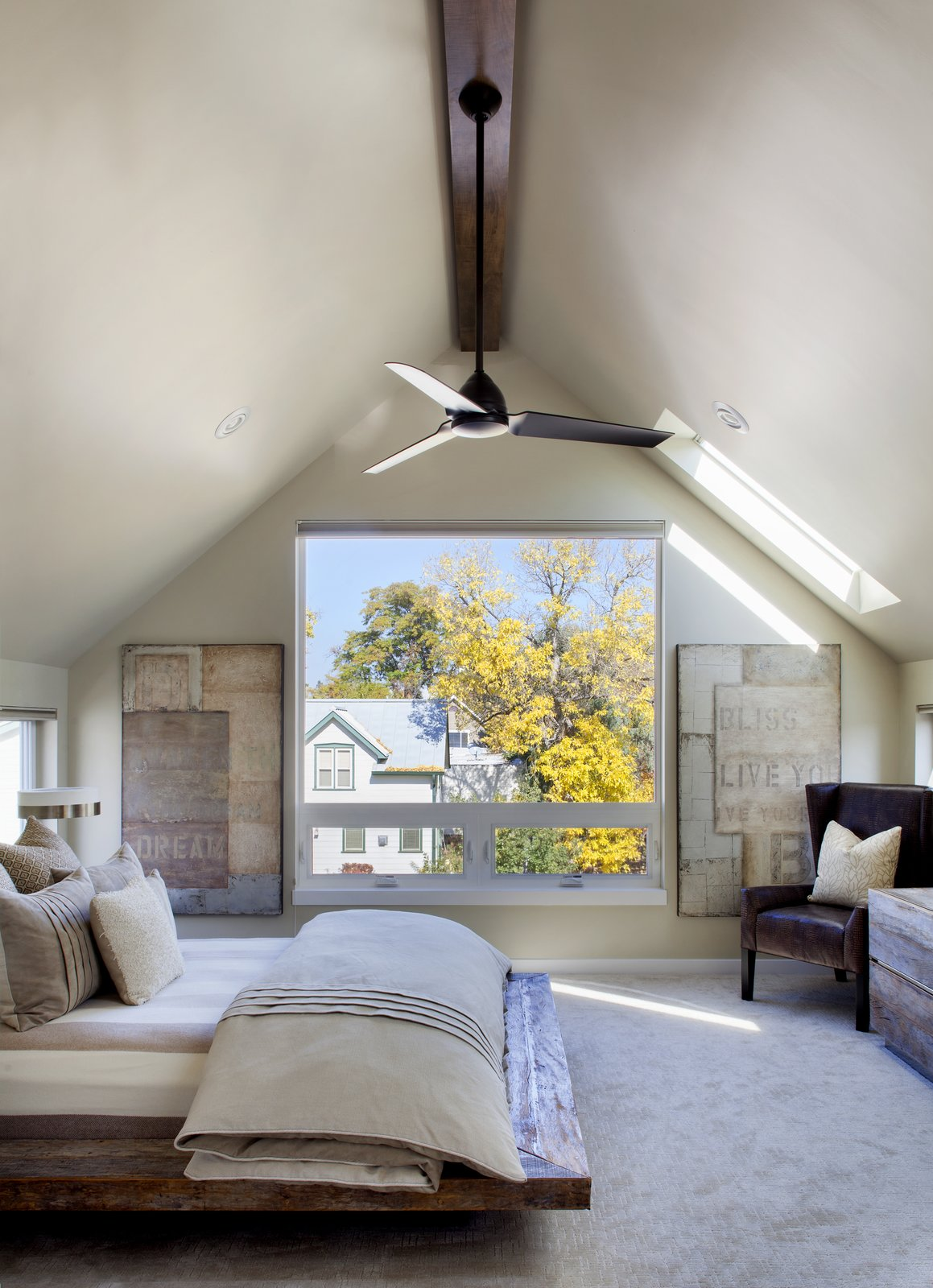 Since this home was primarily for the couple, rather than their grown children, they wanted a luxurious master bedroom. A Kichler fan circulates air above the bed. Modern Homes in Colorado by Luke Hopping
