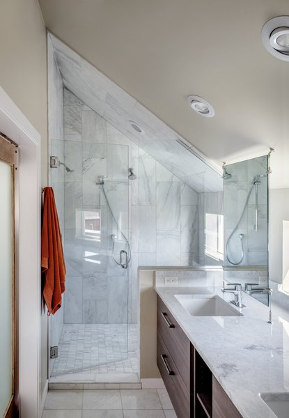 Carrara marble was used in the shower and on the countertops. The fixtures are from Hansgrohe. Photo 6 of Highlands House modern home