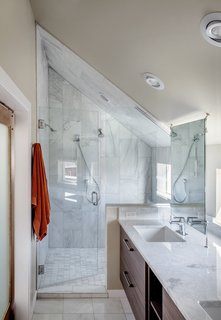 A Couple's Denver Residence Makes Clever Use of a Narrow Plot - Photo 6 of 8 - Carrara marble was used in the shower and on the countertops. The fixtures are from Hansgrohe.