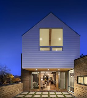 "A Couple's Denver Residence Makes Clever Use of a Narrow Plot - Photo 7 of 8 - ""We were concerned that by elevating the first floor by six feet, we would be detaching the living space from the neighborhood,"" Mitchell says. ""Thus, we have an elevated exterior patio off of the rear that overlooks the sidewalk and brings the living space to the outdoors."""