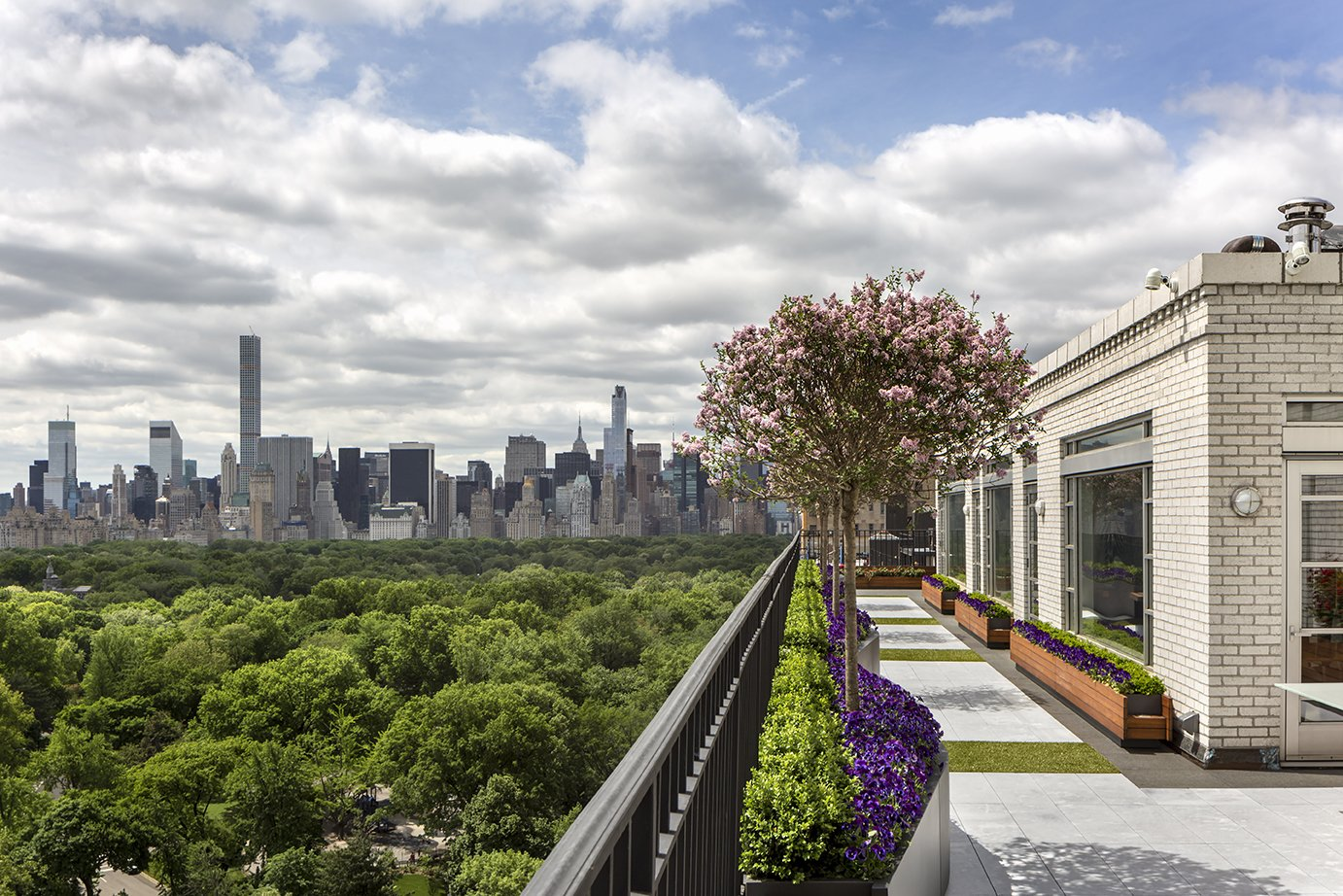Mojo Stumer Associates Architects and landscape architects Town & Gardens partnered to rejuventate an overlooked outdoor area at a Manhattan penthouse. Their objective was to elevate the terrace to match the inviting, modern interiors.  outdoors by Laura McLaughlin from A Renovated Penthouse Garden Has an Unbelievable View of New York City