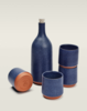 Serving set by Mazama Wares, $210  The midnight-blue speckle of this hand-thrown ceramic bottle and quartet of tumblers is a celestial sight to behold. Also available in ash (black), glass (green), and cloud (gray).
