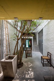 A Narrow Courtyard Joins a Unique Two-Family Home in Saigon - Photo 4 of 10 -
