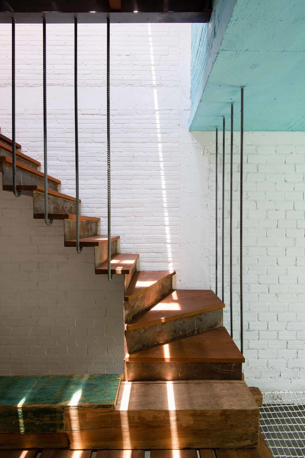Six staircases, many open to outside light, serve as pathways between the private interior spaces.
