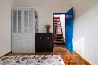 A Narrow Courtyard Joins a Unique Two-Family Home in Saigon - Photo 10 of 10 -
