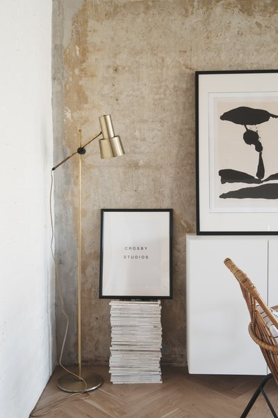 The long white dresser at the end of the living room pops against the concrete, making it an ideal venue to show off souvenirs, collectibles and art. Crosby Studios also occasionally provides graphic design services, as seen by the eponymous framed print shown here. Photo 2 of Soviet Intelligentsia modern home
