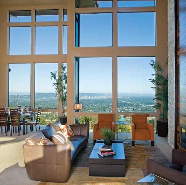 After final decisions are made and installation takes place with the expertise of a local dealer, you'll quickly notice the benefits that come with the inevitable noise reduction. Milgard suggests that double glazed windows and well-designed vinyl frames are two of the best ways to combat noise infiltration. For those windows in which you want to keep closed, consider their Aluminum Picture Windows, shown here in a stunning scale, perfect for enjoying your home's cherished views each and every day.