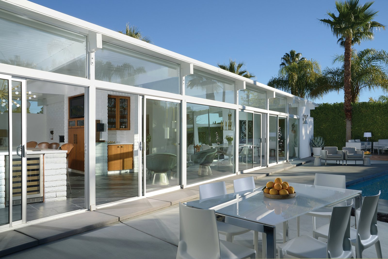 The 1956 all-white La Casa di Ucello Bianca, designed by an unkown architect, was carefully restored by its current owners. Tagged: Exterior, House, and Mid-Century Building Type.  Midcentury Homes by Dwell from A New Book Documents the Rarely-Seen Midcentury Modern Gems of Palm Springs