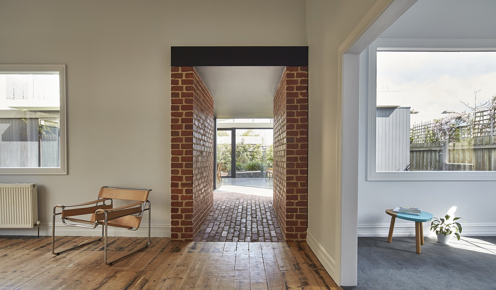 """Instead of extending the new living area from the existing house, we decided to build a stand-alone structure off the front house and connect the two spaces with a central passageway,"" Ong says. This made the back of the home distinctive from the Edwardian front. Recyled brick was used to create the connecting hallway."