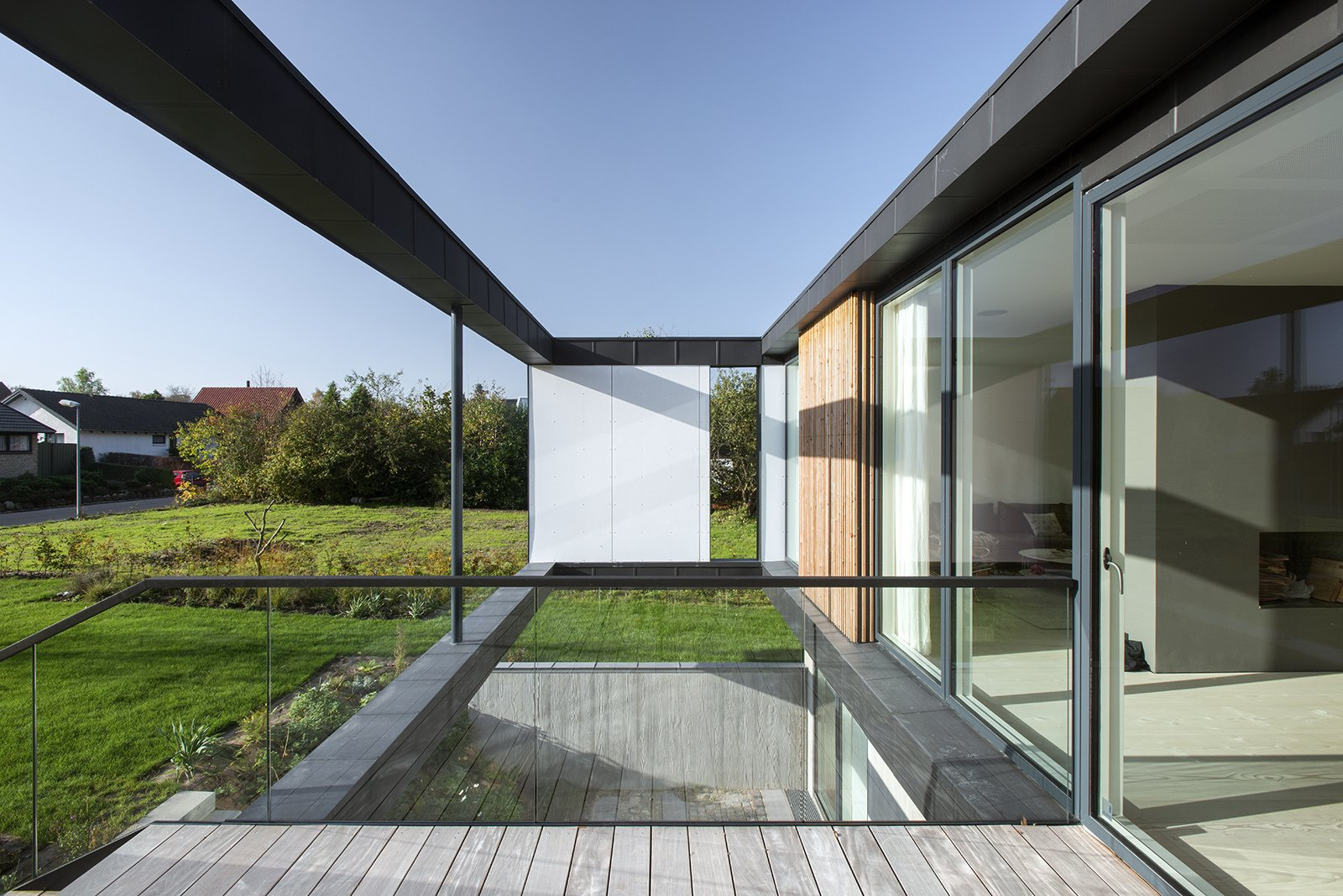 Floor-to-ceiling glass walls allow natural daylight to enter the home.  Villa R by Diana Budds