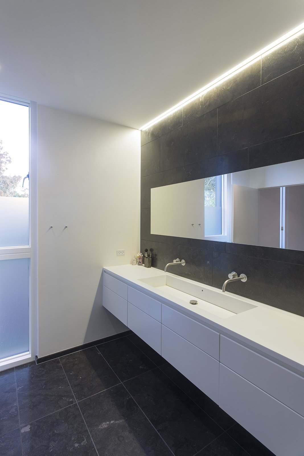 Vola fixtures are used in the bathroom.  Villa R by Diana Budds