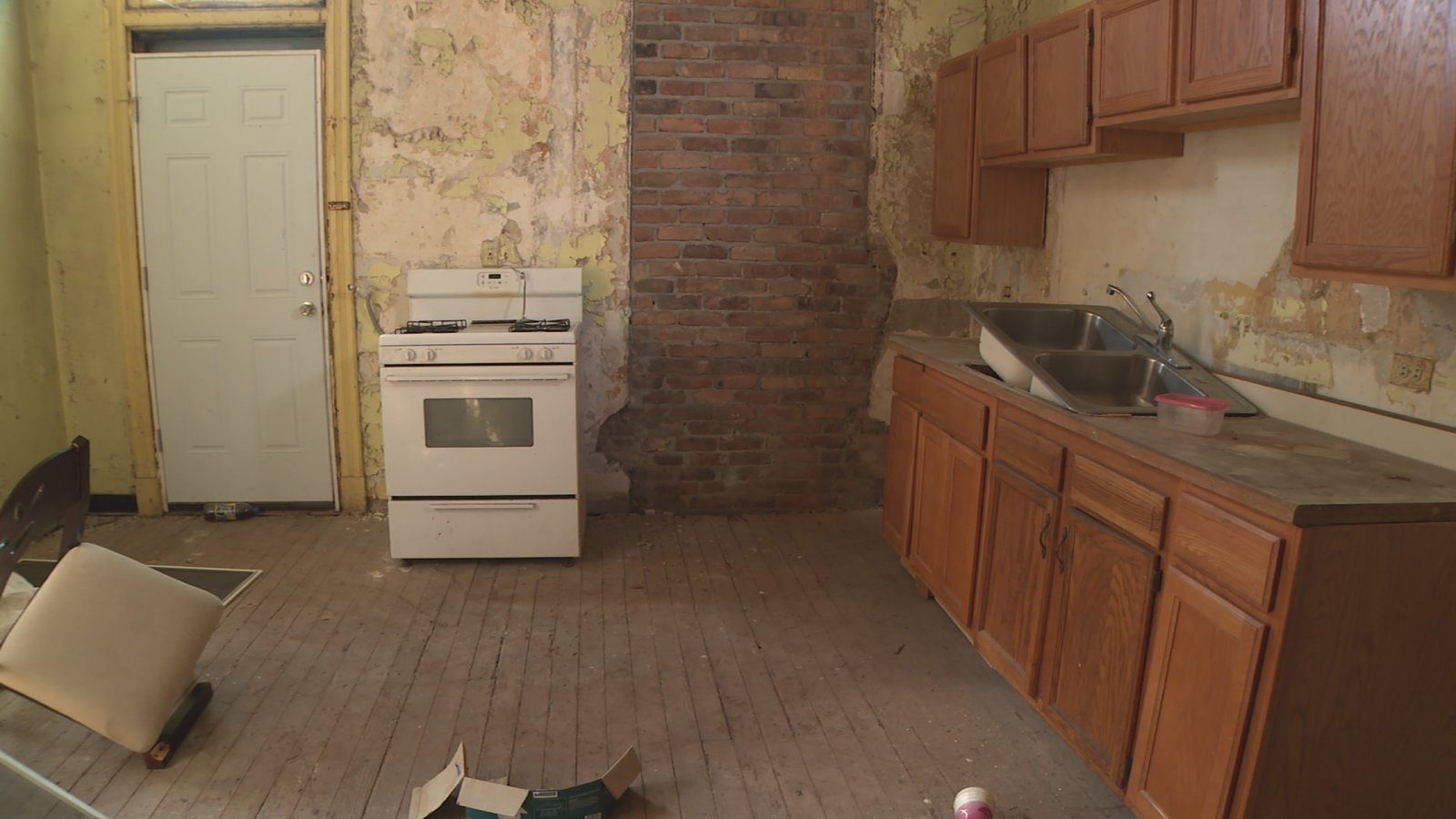 "A ""before"" view of the kitchen.  Photo 2 of 4 in The Winning Renovation of Rowhouse Showdown"