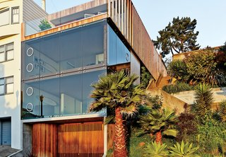 10 Modern Glass Homes - Photo 10 of 10 - For a San Francisco couple living on a hill overlooking the Mission District in San Francisco, glass walls were a must. Indoor louvers allow the residents to frame their view of the city, much like the aperture on a camera.