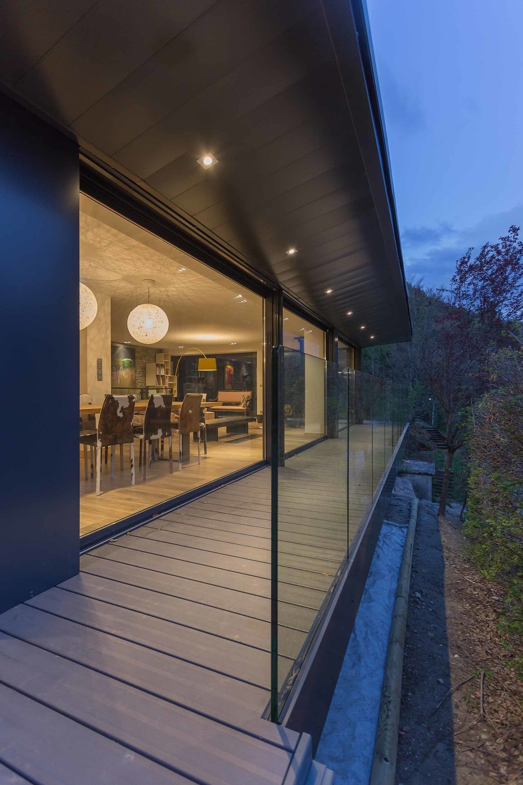 The interior is furnished with contemporary pieces that don't detract from views of the surrounding valley.  Photo 4 of 8 in A Mountain Hideaway Plants a Green Roof in the French Alps