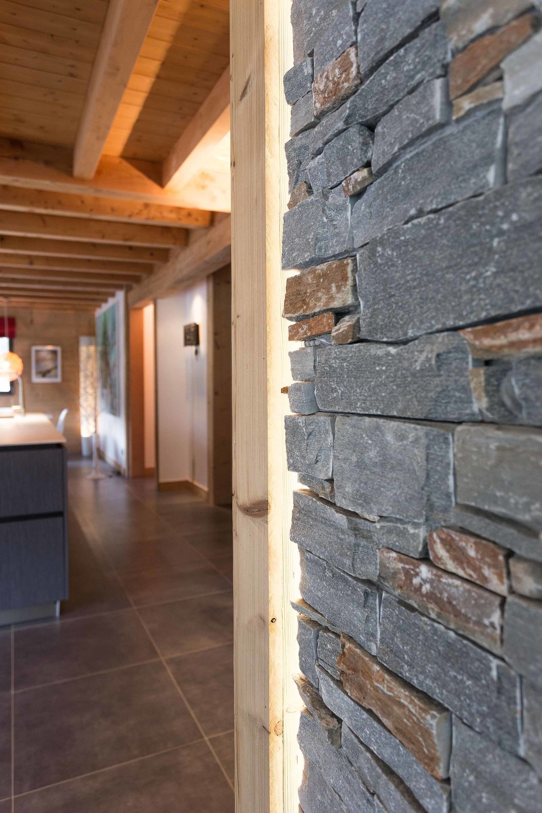 Wood and stone elements add to the rustic atmosphere inside, resulting in a home that feels like a natural extension of the landscape.