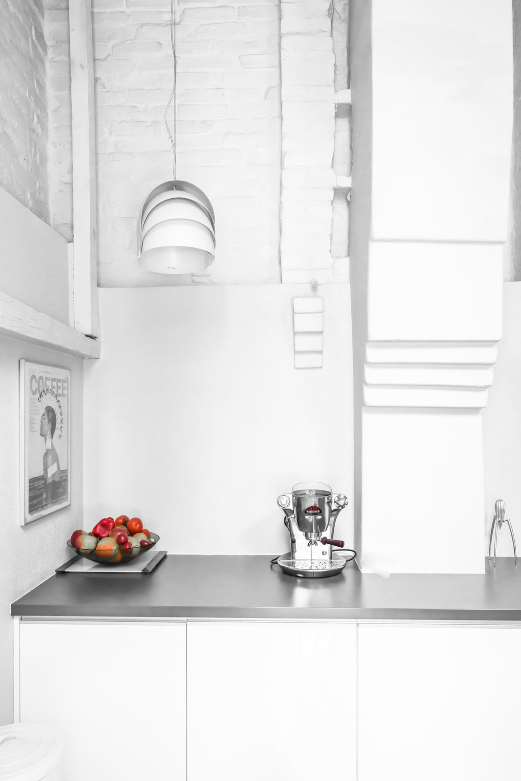 A bright corner in the kitchen houses an Electra coffee maker and a quirky pendant lamp by Lightyears. Tagged: Kitchen and White Cabinet.  Photo 8 of 10 in A Run-Down Farmhouse Becomes a Sleek Modern Retreat