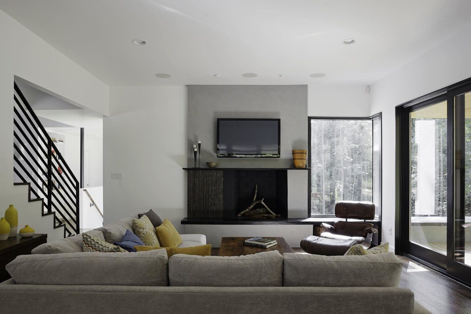 """""""We had to take into consideration that this young family was going to be living on a viable farm,"""" says interior designer Kris Ozburn of Second Mile Design. """"So, selecting furniture that was practical but had good design was a priority."""" Ozburn chose pieces like the sectional sofa from Precedent that felt timeless and modern."""