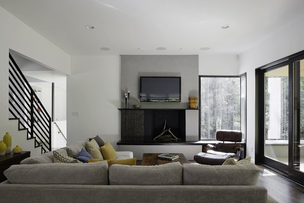 """""""We had to take into consideration that this young family was going to be living on a viable farm,"""" says interior designer Kris Ozburn of Second Mile Design. """"So, selecting furniture that was practical but had good design was a priority."""" Ozburn chose pieces like the sectional sofa from Precedent that felt timeless and modern. Photo 5 of The Farmhouse modern home"""
