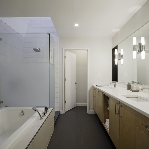 Only one shade of paint was used in the interior of the home, including the bathroom: Sherwin-Williams's Harmony. Photo 7 of The Farmhouse modern home