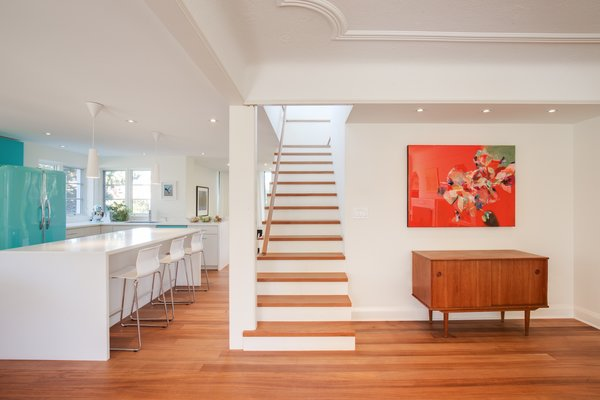 Benjamin Moore's Cloud White paint color, which was used throughout the home, lets the African mahogany flooring stand out. Photo 5 of Art Moderne modern home