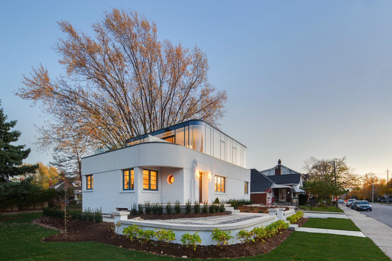 The home's white stucco exterior is actually a thin layer of stucco spread over a modern EIFS (Exterior Insulation and Finishing System) from Dryvit.  Minimalist Facades We Love by Zachary Edelson from Art Moderne