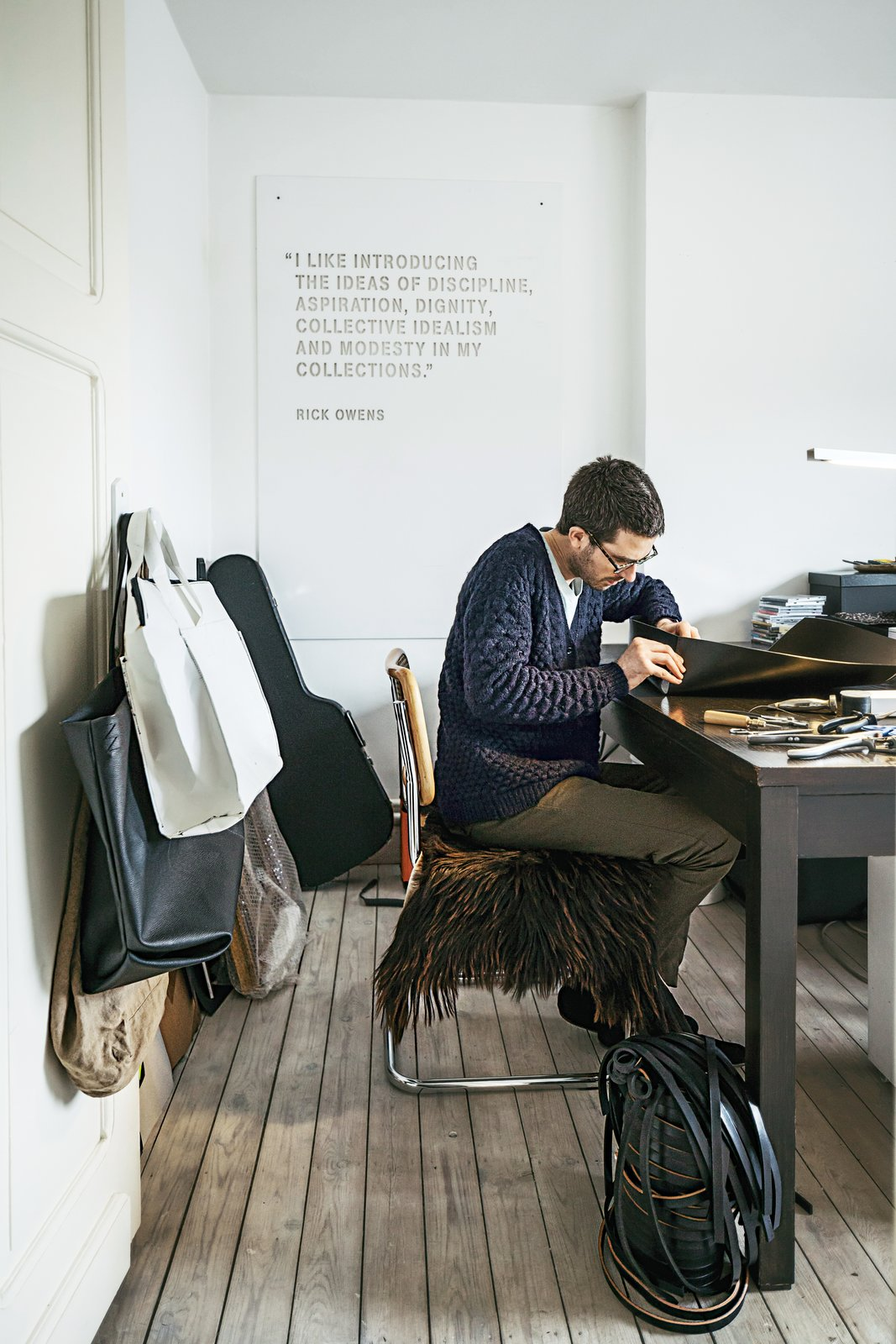 Verheyden works at his desk in the home office; over-flow projects are tackled in the workshop adjacent to the house, which is covered in black wood. Tagged: Office, Medium Hardwood Floor, Study, and Desk.  Best Photos from A Clever Belgian Couple Renovate Their Aging Brick Home