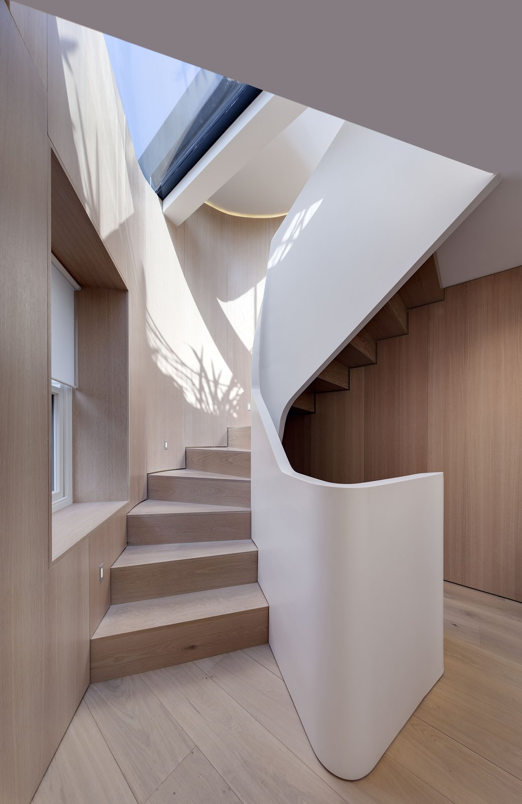 FORMstudio designed an acrylic balustrade that winds up the 1,647-square-foot home's five levels. The flooring throughout is white oak. 190+ Best Modern Staircase Ideas by Dwell