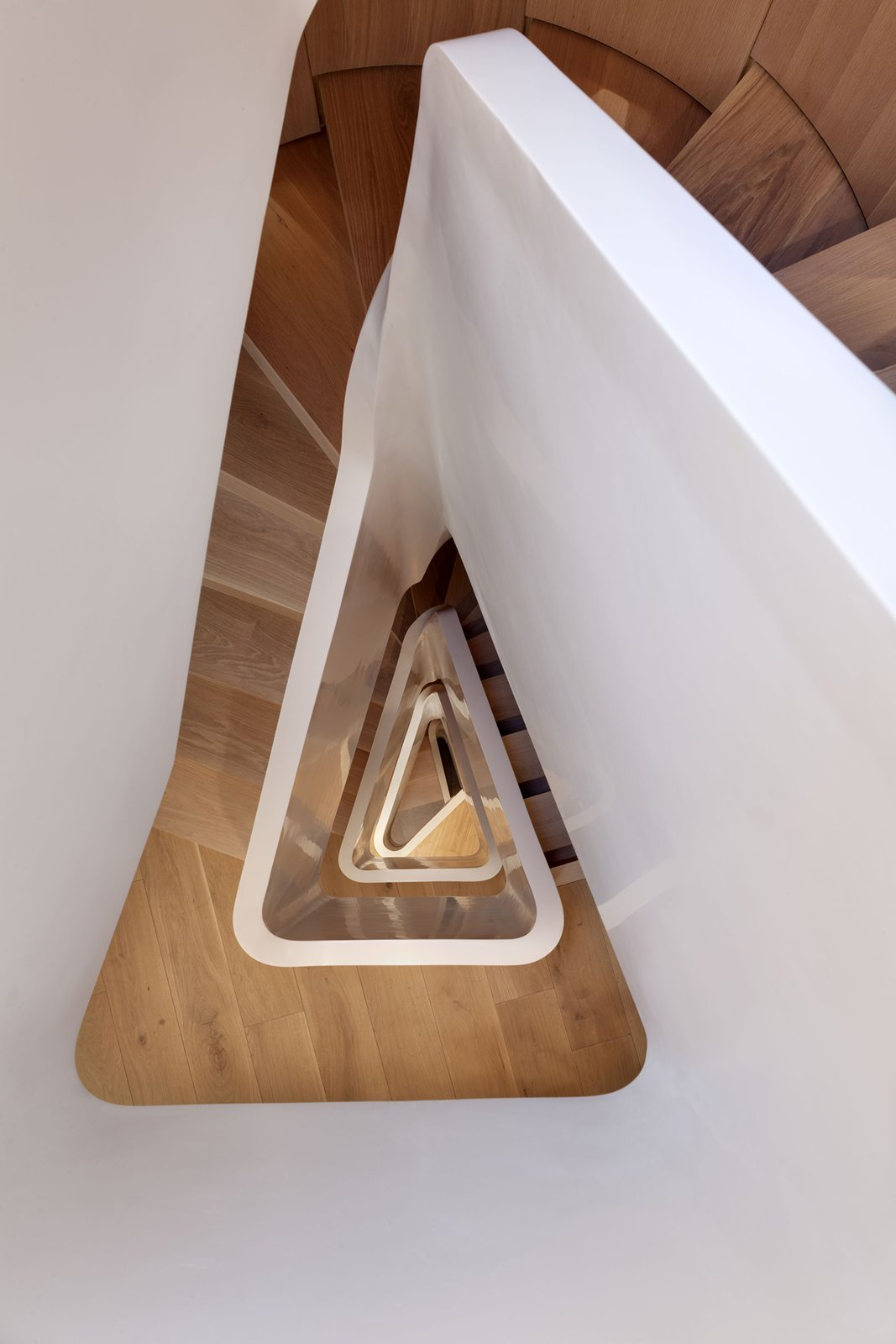 The staircase is about 46 feet tall from top to bottom. Tagged: Staircase and Wood Tread.  190+ Best Modern Staircase Ideas by Dwell from Amazing Five-Story Staircase Twists Through a Narrow London Home