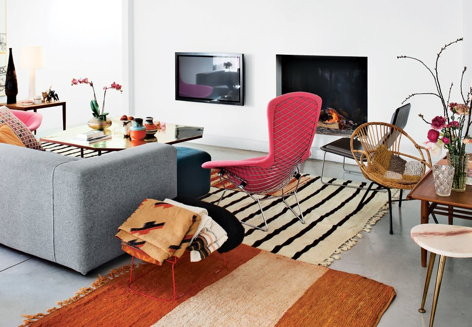A good combination of two rugs can be better than one, so don't be afraid to mix and match. Two antique rugs from Morocco complement each other perfectly in this Belgian home.