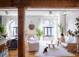 45 Pets in Beautiful Modern Homes - Photo 35 of 45 - Exposed structural beams are a historic nod to the loft's previous life as a 19th-century warehouse and shipping dock. For the Copes, inspiration for creative projects never draws far from home; they named Calico after their cat, Irie.
