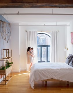 "12 ""Pro-Tips"" For Installing Wallpaper in Your Home - Photo 13 of 13 - Aurora Ray, a color-gradient wallpaper inspired by the sunset as seen from Red Hook, accents the master bedroom, furnished with a custom bed frame by VIDIVIXI. The couple also designed a collection named after their daughter, Willow, exploring the movement of water and trees."