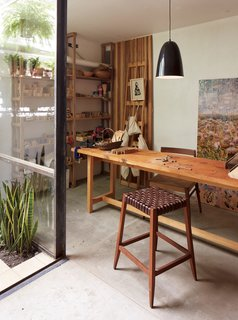 One-of-a-Kind Furniture Fills This Delightfully Serene Buenos Aires Home - Photo 9 of 10 - In her workshop, which features a Mercedes table, an Otto lamp, and a wood-and-leather bar stool, all by NET, she creates a line of uncomplicated wood toys called Sarmiento.