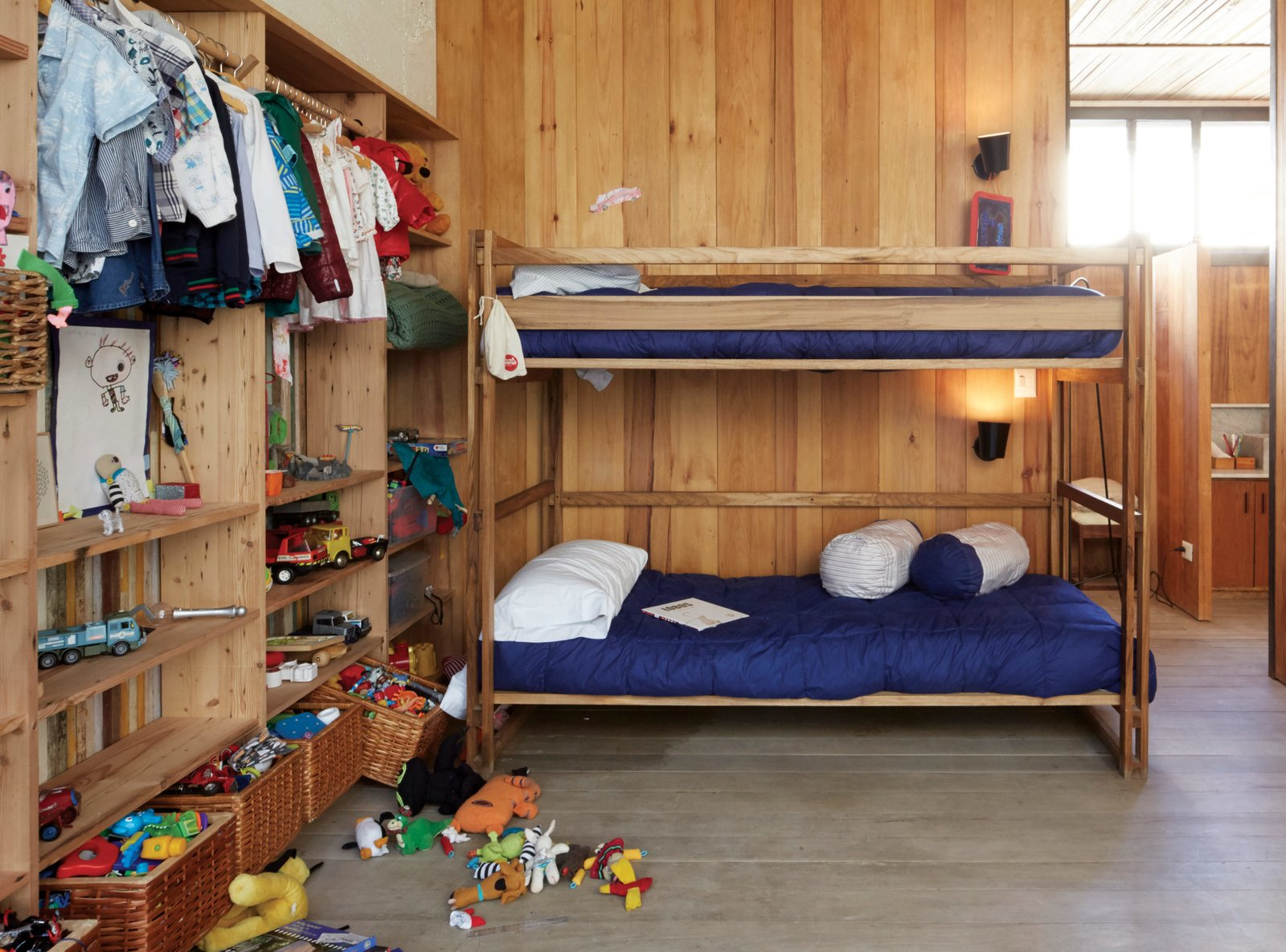 The children's bedroom features NET bunk beds and storage baskets from Mono, the design shop of Sticotti's wife, Mercedes Hernáez.