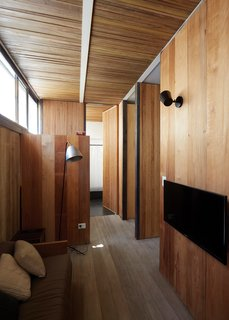 8 Beautiful Home Projects Using Reclaimed Wood - Photo 1 of 8 - Salvaged wood from multiple origins come together in this project in Buenos Aires by architects Teresa Sarmiento and Nicolas Tovo. They designed the home for their own family with the intention of celebrating recycled materials—floor boards of repurposed Brazilian pine and wall boards from the ceiling of a tenement in a local Buenos Aires neighborhood. The boards were cut down to size and oriented vertically to bring the eye upward to a clerestory window and small white beams.