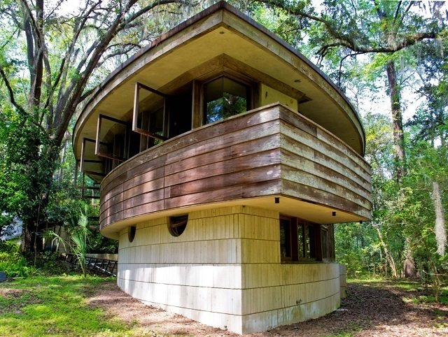 "The ""hemicycle"" layout of the house is one of only 12 or 13 similar structures designed by Frank Lloyd Wright around the world.  Frank Lloyd Wright's Endangered Spring House  by Allie Weiss"