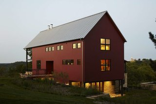 These 10 Refreshed Barns Bring Modern Living to the Countryside - Photo 3 of 10 - From red painted cedar siding to no-fuss structural elements, Northworks' solution reaches a happy medium between the classic barn look and a weekend retreat.