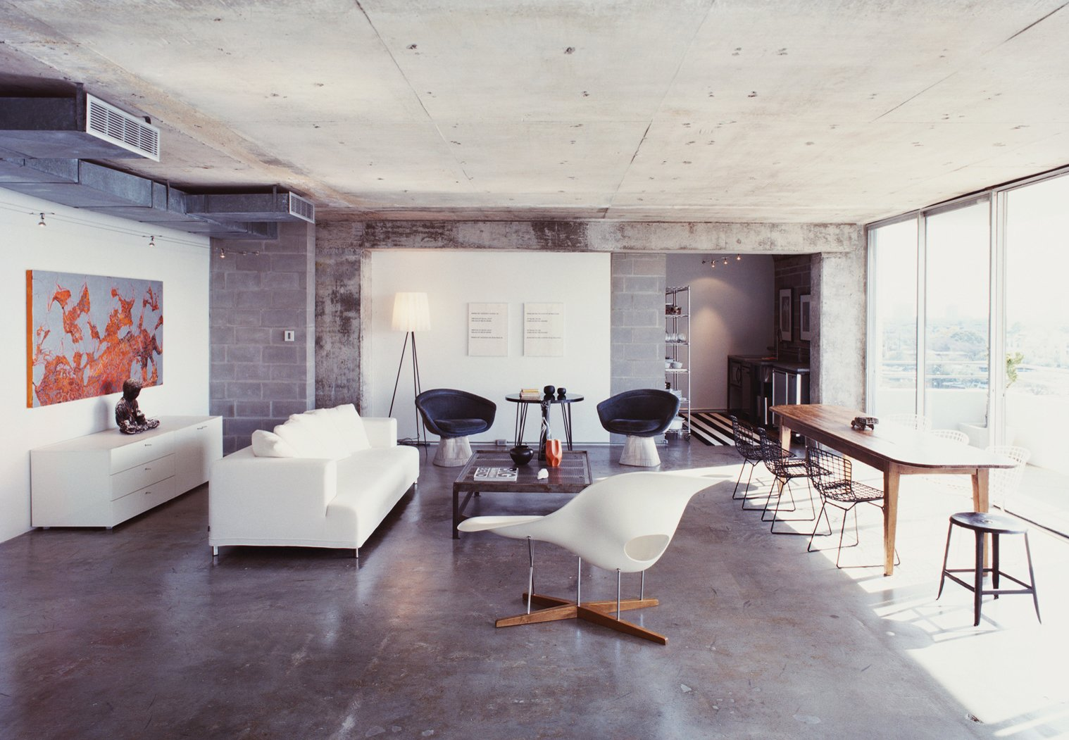 "When Barbara Hill purchased a 1960s Houston condo she completely stripped its interior, seeking a minimal restart. When the apartment was down to its original mottled concrete walls and floors Hill decided to keep everything exactly the way it was. ""Once I saw the exposed space, I couldn't bear to put anything back,"" she says.  Striking Exposed Concrete Interiors by William Harrison"