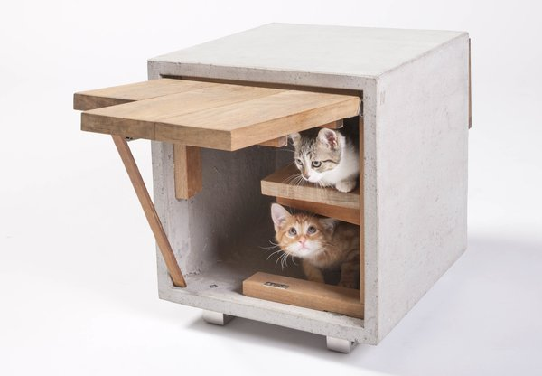 The Cat Cube by Standard Architecture | Design of Los Angeles has two openings and is made with reclaimed wood and concrete. The concrete heats up during the day to provide strays with a source of warmth at night.