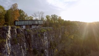 Watch How a Sculptor's Cliffside Glass House Seems to Grow Out of the Rocks - Photo 5 of 5 - The sheer amount of glass encasing the house warrants a strong connection to the natural beauty of the grounds, and serves as a constant reminder of its surroundings.