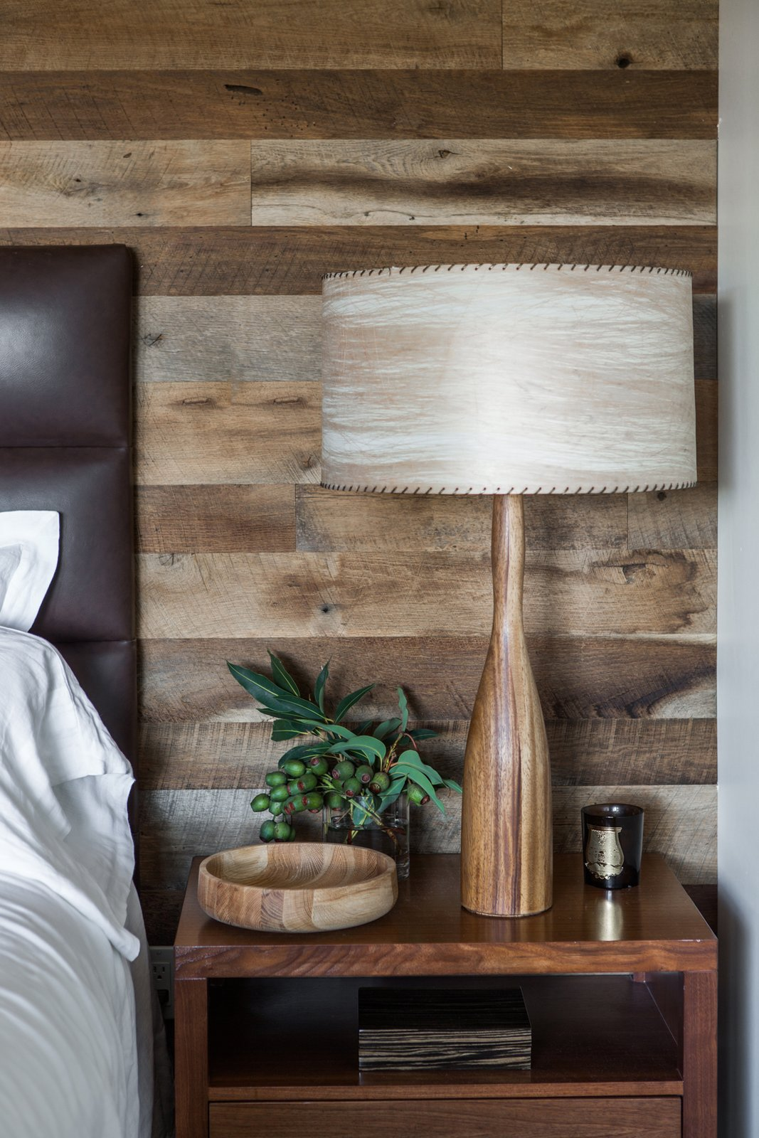 """A vintage wood lamp and turned bowl stands next to the bed. """"We wanted to incorporate elements used in residential homes,"""" Hollis says of the eclectic medley of accessories and furnishings in the space. """"These would be items that you would collect over time. They don't exactly match, but they all work together—they create a relaxed casual environment while still elevating the interior and amenities to what you expect from a world-class luxury property."""" Tagged: Bedroom, Bed, Table Lighting, and Night Stands.  60+ Modern Lighting Solutions by Dwell from A Serene Hotel in Carmel, California"""