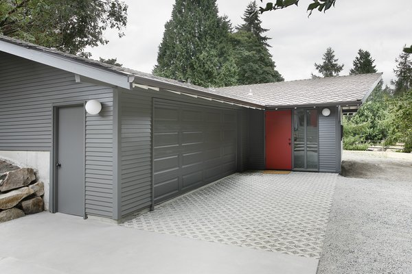 """The stable/garage was built with two intersecting gable roof forms,"" Schaer says, which didn't match up with the inteiror spaces within. ""In order to provide a unified, singular main space, we dropped a flat ceiling at the entrance and linked it up with the main gable visible from the street."""