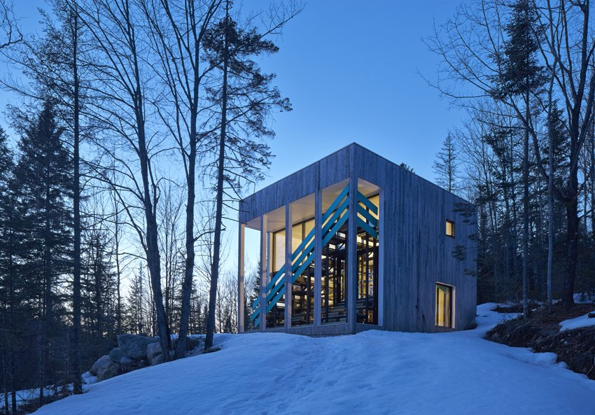 The home's cubed shape keeps the footprint small, while the overhang was designed to accommodate the changing angle of the sun. It prevents overheating in summer while admitting as much winter sunlight as possible.  Cabins & Hideouts by Stephen Blake from Dozens of Levels Give a Quebec Home Stadium-Sized Views of the Forest