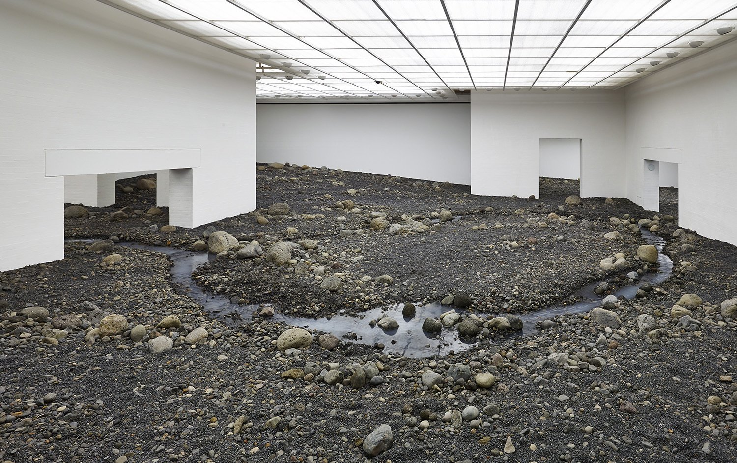 """Riverbed,"" Olafur Eliasson, 2014.  This site-specific installation for the Louisiana Museum of Modern Art in Humlebæk, Denmark, creates a complete rocky enviornment inside the white-walled gallery.  Eight of Our Favorite Works by Artist Olafur Eliasson by Allie Weiss"