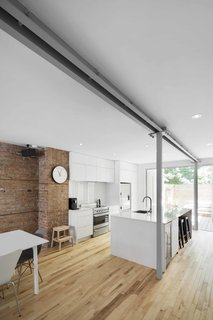 Blocked in on Two Sides, a Renovation Opens a Quebec Apartment to Tons of Natural Light - Photo 3 of 8 -