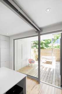 Blocked in on Two Sides, a Renovation Opens a Quebec Apartment to Tons of Natural Light - Photo 4 of 8 -