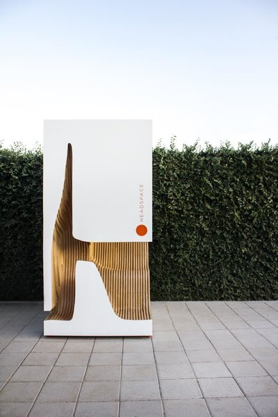 Headspace, a website and app for teaching self-care and mindfulness, has teamed with Californian architect duo Oyler Wu to design an experience that embodies the spirit of meditation and enhances its practices. What they came up is a simple pod, hollowed out with a curvilinear interior made of layered, machine-cut wood that rests on a steel frame.