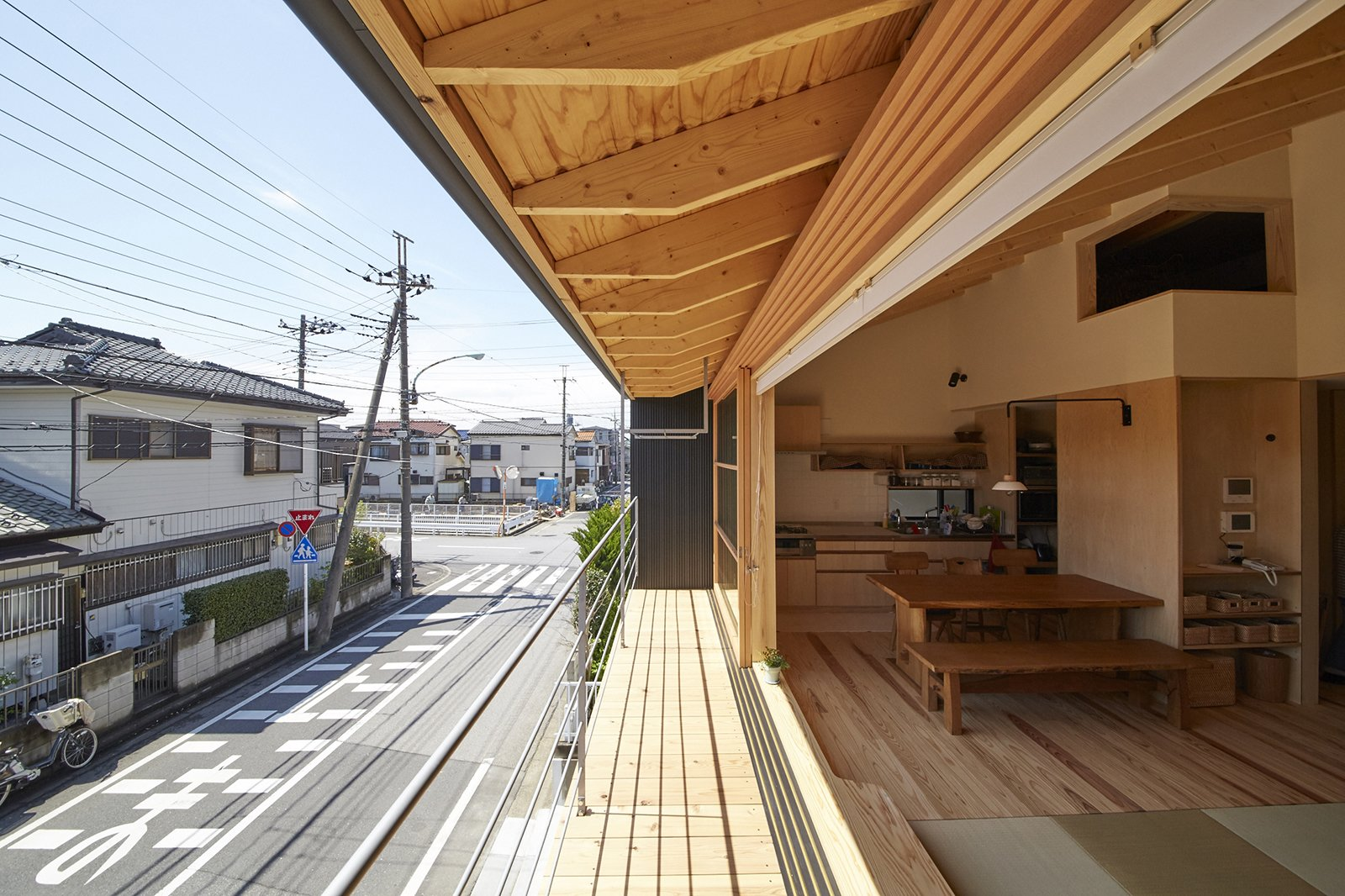 The sliding wood and glass panel alludes to traditional Japanese shoji screens—sliding partitions constructed of wood and translucent paper. For the house's wooden construction, co-design studio used Japanese cedar, sugi, and Japanese cypress, hinoki, both local to the larger Saitama prefecture.