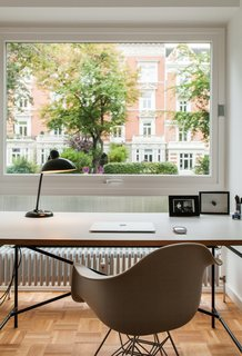 We Can't Get Enough of This German Apartment's Sleek Matte-Black Kitchen - Photo 11 of 11 - A small office for Dorothee, furnished with a desk by German architect Egon Eiermann and an Eames chair, overlooks the street.