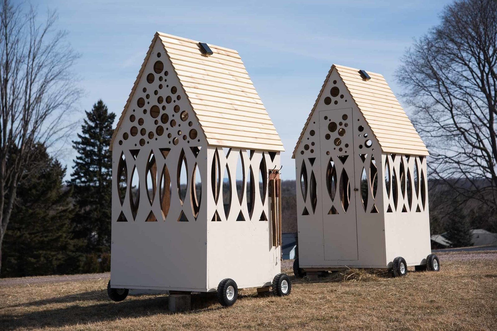 """All Things Sweet and Sour,"" Selin + Selin Architecture   Drawing a straight line between the contemplative nature of ice shanties and houses of worship, Selin + Selin Architecture built two pitched-roof mini chapels so they could be in dialogue with each other."